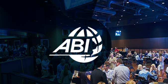ABI logo imposed over a people attending the ABI conference.