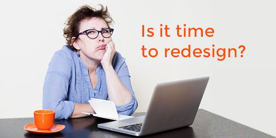 woman thinking if it is time to redesign her website